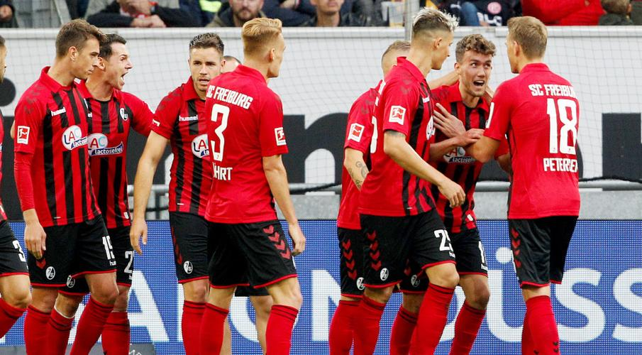 Freiburg up to third after comeback win at Duesseldorf