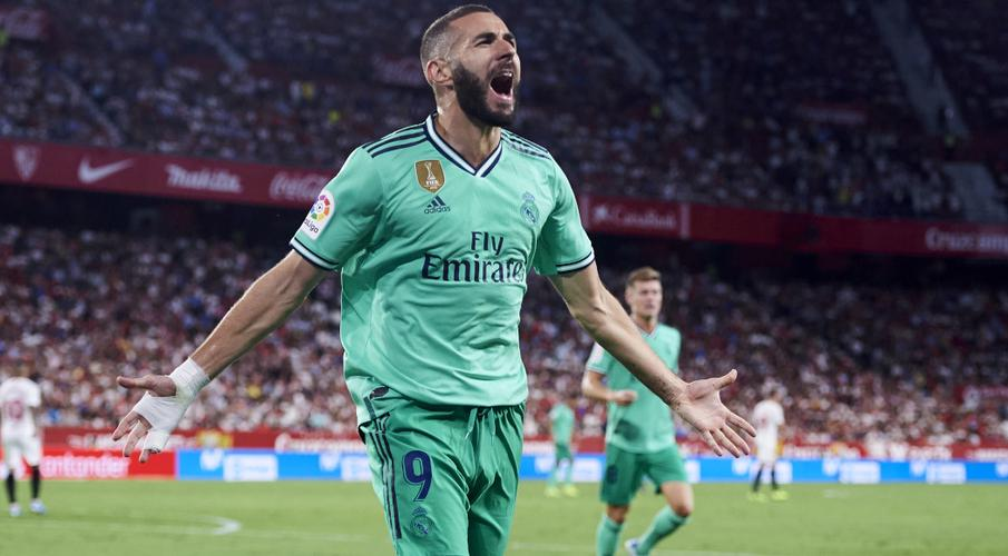 Benzema header beats Sevilla and breathes life back into Real