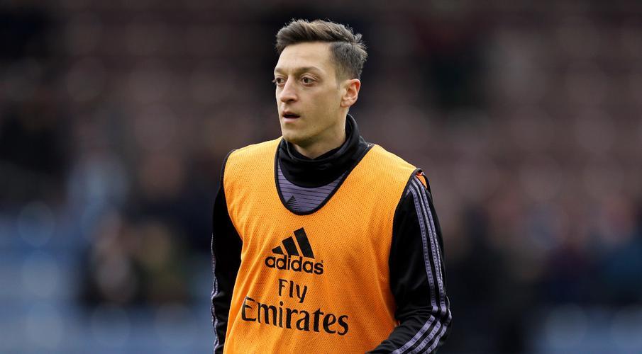 Two men threatened to 'kill' Arsenal's Ozil